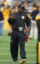 Aug 10, 2013; Pittsburgh, PA, USA; Pittsburgh Steelers head coach Mike Tomlin walks on the field before the game against the New York Giants during the first quarter at Heinz Field. Mandatory Credit: Jason Bridge-USA TODAY Sports