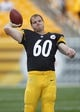Aug 10, 2013; Pittsburgh, PA, USA; Pittsburgh Steelers long snapper Greg Warren (60) tosses a football before playing the New York Giants  at Heinz Field. The New York Giants won 18-13. Mandatory Credit: Charles LeClaire-USA TODAY Sports
