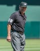 Aug 15, 2013; Oakland, CA, USA; Umpire Angel Hernandez (55) winks at the camera during the sixth inning of the game between the Oakland Athletics and Houston Astros at O.Co Coliseum. The Oakland Athletics defeated the Houston Astros 5-0. Mandatory Credit: Ed Szczepanski-USA TODAY Sports