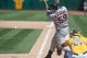 Aug 15, 2013; Oakland, CA, USA; Houston Astros left fielder Marc Krauss (59) hits a double against the Oakland Athletics during the ninth inning at O.Co Coliseum. The Oakland Athletics defeated the Houston Astros 5-0. Mandatory Credit: Ed Szczepanski-USA TODAY Sports