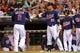 Aug 15, 2013; Minneapolis, MN, USA; Minnesota Twins second baseman Brian Dozier (2) celebrates with left fielder Oswaldo Arcia (31) after scoring a run in the sixth inning against the Chicago White Sox at Target Field. Mandatory Credit: Jesse Johnson-USA TODAY Sports