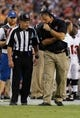 Aug 8, 2013; Tampa, FL, USA; Tampa Bay Buccaneers head coach Greg Schiano talks with the referee against the Baltimore Ravens during the first quarter at Raymond James Stadium. Mandatory Credit: Kim Klement-USA TODAY Sports