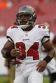 Aug 8, 2013; Tampa, FL, USA; Tampa Bay Buccaneers running back Michael Smith (34) prior to the game against the Baltimore Ravens at Raymond James Stadium. Mandatory Credit: Kim Klement-USA TODAY Sports