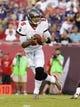 Aug 8, 2013; Tampa, FL, USA; Tampa Bay Buccaneers quarterback Josh Freeman (5) drops back during the first quarter against the Baltimore Ravens at Raymond James Stadium. Mandatory Credit: Kim Klement-USA TODAY Sports
