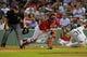 Aug 16, 2013; Boston, MA, USA; New York Yankees right fielder Ichiro Suzuki (31) slides safely past Boston Red Sox catcher Jarrod Saltalamacchia (39) during the ninth inning at Fenway Park. Mandatory Credit: Bob DeChiara-USA TODAY Sports