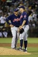 Aug 17, 2013; Oakland, CA, USA; Cleveland Indians shortstop Asdrubal Cabrera (13) speaks with starting pitcher Ubaldo Jimenez (30) after allowing his first hit of the  game against the Oakland Athletics during the sixth inning at O.co Coliseum. Mandatory Credit: Kelley L Cox-USA TODAY Sports