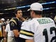 Aug 17, 2013; St. Louis, MO, USA; St. Louis Rams quarterback Sam Bradford (8) talks with Green Bay Packers quarterback Aaron Rodgers (12) after a game at the Edward Jones Dome. Mandatory Credit: Jeff Curry-USA TODAY Sports
