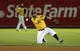 Aug 17, 2013; Oakland, CA, USA; Oakland Athletics shortstop baseman Eric Sogard (28) throws the ball after making a diving catch against the Cleveland Indians during the eighth inning at O.co Coliseum. Mandatory Credit: Kelley L Cox-USA TODAY Sports