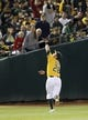 Aug 17, 2013; Oakland, CA, USA; Oakland Athletics shortstop baseman Eric Sogard (28) catches the ball against the Cleveland Indians during the eighth inning at O.co Coliseum. Mandatory Credit: Kelley L Cox-USA TODAY Sports