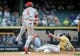 Aug 18, 2013; Milwaukee, WI, USA; Cincinnati Reds second baseman Brandon Phillips (left) turns a double play after forcing out Milwaukee Brewers left fielder Logan Schafer (right) in the 9th inning at Miller Park. The Reds beat the Brewers 9-1.  Mandatory Credit: Benny Sieu-USA TODAY Sports