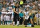 Aug 9, 2013; Jacksonville, FL, USA; Jacksonville Jaguars kicker Josh Scobee (10) gets ready to kick a field goal during the second quarter against the Miami Dolphins at EverBank Field. Mandatory Credit: Kim Klement-USA TODAY Sports