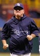 Aug 15, 2013; St. Petersburg, FL, USA; Tampa Bay Rays manager Joe Maddon (70) against the Seattle Mariners at Tropicana Field. Tampa Bay Rays defeated the Seattle Mariners 7-1. Mandatory Credit: Kim Klement-USA TODAY Sports
