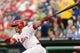 Aug 19, 2013; Philadelphia, PA, USA; Philadelphia Phillies catcher Carlos Ruiz (51) doubles during the first inning against the Colorado Rockies at Citizens Bank Park. Mandatory Credit: Howard Smith-USA TODAY Sports