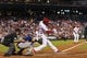 Aug 19, 2013; Philadelphia, PA, USA; Philadelphia Phillies center fielder John Mayberry (15) hits a three run home run during the fourth inning against the Colorado Rockies at Citizens Bank Park. Mandatory Credit: Howard Smith-USA TODAY Sports