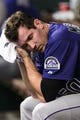 Aug 19, 2013; Philadelphia, PA, USA; Colorado Rockies pitcher Jeff Manship (50) in the dugout prior to playing the Philadelphia Phillies at Citizens Bank Park. The Phillies defeated the Rockies 5-4. Mandatory Credit: Howard Smith-USA TODAY Sports