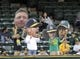 Aug 19, 2013; Oakland, CA, USA; Oakland Athletics fans hold up signs in the outfield during the game between the Oakland Athletics and Seattle Mariners at O.Co Coliseum. Mandatory Credit: Ed Szczepanski-USA TODAY Sports