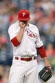 Aug 20, 2013; Philadelphia, PA, USA; Philadelphia Phillies pitcher Tyler Cloyd (50) wipes his face after giving up a two run home run during the first inning against the Colorado Rockies at Citizens Bank Park. Mandatory Credit: Howard Smith-USA TODAY Sports