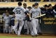 Aug 20, 2013; Oakland, CA, USA; Seattle Mariners center fielder Michael Saunders (55) celebrates with teammates after scoring a run against the Oakland Athletics during the eighth inning at O.co Coliseum. The Seattle Mariners defeated the Oakland Athletics 7-4. Mandatory Credit: Kelley L Cox-USA TODAY Sports