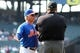 Aug 21, 2013; New York, NY, USA; New York Mets manager Terry Collins (10) argues with first base umpire Jerry Layne (24) after New York Mets first baseman Daniel Murphy (not pictured) was ejected during the tenth inning of a game at Citi Field. Collins would also be ejected from the game. Mandatory Credit: Brad Penner-USA TODAY Sports
