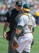 Aug 21, 2013; Oakland, CA, USA; Home plate umpire Chad Fairchild (75) and Oakland Athletics catcher Stephen Vogt (21) discuss a call during the sixth inning of the game against the Seattle Mariners at O.Co Coliseum. Mandatory Credit: Ed Szczepanski-USA TODAY Sports