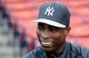Aug 16, 2013; Boston, MA, USA; New York Yankees left fielder Alfonso Soriano (12) talks with a reporter prior to a game against the Boston Red Sox at Fenway Park. Mandatory Credit: Bob DeChiara-USA TODAY Sports