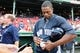 Aug 16, 2013; Boston, MA, USA; New York Yankees right fielder Curtis Granderson (14) signs an autograph prior to a game against the Boston Red Sox at Fenway Park. Mandatory Credit: Bob DeChiara-USA TODAY Sports