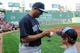 Aug 16, 2013; Boston, MA, USA; New York Yankees relief pitcher Mariano Rivera (42) signs an autograph prior to a game against the Boston Red Sox at Fenway Park. Mandatory Credit: Bob DeChiara-USA TODAY Sports