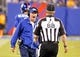 Aug 18, 2013; East Rutherford, NJ, USA; New York Giants head coach Tom Coughlin argues with field judge Scott Steenson (88) during the first half against the Indianapolis Colts at MetLife Stadium. Mandatory Credit: Jim O'Connor-USA TODAY Sports