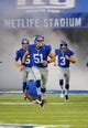 Aug 18, 2013; East Rutherford, NJ, USA; New York Giants long snapper Zak DeOssie (51) punter Steve Weatherford (5) and kicker Josh Brown (3) take the field against the Indianapolis Colts at MetLife Stadium. Mandatory Credit: Jim O'Connor-USA TODAY Sports