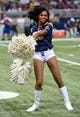 Aug 17, 2013; St. Louis, MO, USA; A St. Louis Rams cheerleader performs during the second half against the Green Bay Packers at the Edward Jones Dome. Mandatory Credit: Scott Rovak-USA TODAY Sports