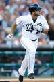 Aug 3, 2013; Detroit, MI, USA; Detroit Tigers shortstop Jhonny Peralta (27) hits a home run in the second inning against the Chicago White Sox at Comerica Park. Mandatory Credit: Rick Osentoski-USA TODAY Sports