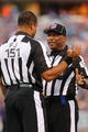 Aug 16, 2013; Orchard Park, NY, USA;  NFL field judge Clay Reynard and line judge Darryll Lewis (130) talk during a stoppage in play during a game between the Buffalo Bills and the Minnesota Vikings at Ralph Wilson Stadium.  Mandatory Credit: Timothy T. Ludwig-USA TODAY Sports