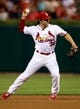 Aug 22, 2013; St. Louis, MO, USA; St. Louis Cardinals shortstop Pete Kozma (38) fields the ball for an out in the third inning against the Atlanta Braves at Busch Stadium. Mandatory Credit: Scott Kane-USA TODAY Sports
