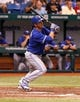 Aug 17, 2013; St. Petersburg, FL, USA; Toronto Blue Jays catcher J.P. Arencibia (9) singles during the second inning against the Tampa Bay Rays at Tropicana Field. Mandatory Credit: Kim Klement-USA TODAY Sports