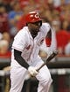 Aug 23, 2013; Cincinnati, OH, USA; Cincinnati Reds second baseman Brandon Phillips (4) singles during the fourth inning against the Milwaukee Brewers at Great American Ball Park. Mandatory Credit: Frank Victores-USA TODAY Sports