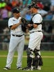 Aug 24, 2013; Chicago, IL, USA; Chicago White Sox starting pitcher Hector Santiago (left) meets with Chicago White Sox catcher Tyler Flowers (right) during the second inning against the Texas Rangers at US Cellular Field. Mandatory Credit: Dennis Wierzbicki-USA TODAY Sports