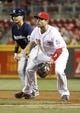 Aug 24, 2013; Cincinnati, OH, USA; Milwaukee Brewers right fielder Norichika Aoki (7) watches at first next to Cincinnati Reds first baseman Joey Votto (19) during a game at Great American Ball Park. The Reds defeated the Brewers 6-3.Mandatory Credit: David Kohl-USA TODAY Sports