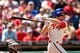 Aug 25, 2013; Philadelphia, PA, USA; Philadelphia Phillies third baseman Cody Asche (25) hits a two RBI double during the first inning against the Arizona Diamondbacks at Citizens Bank Park. Mandatory Credit: Howard Smith-USA TODAY Sports
