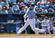 Aug 25, 2013; Kansas City, MO, USA; Kansas City Royals first basemen Eric Hosmer (35) singles in a run against the Washington Nationals during the first inning at Kauffman Stadium.  Mandatory Credit: Peter G. Aiken-USA TODAY Sports
