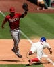Aug 25, 2013; Philadelphia, PA, USA; Arizona Diamondbacks first baseman Paul Goldschmidt (44) is unable to handle the throw as Philadelphia Phillies second baseman Kevin Frandsen (28) dives into first base during the fourth inning at Citizens Bank Park. Mandatory Credit: Howard Smith-USA TODAY Sports
