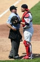 Aug 25, 2013; St. Louis, MO, USA; St. Louis Cardinals catcher Yadier Molina (4) defends starting pitcher Lance Lynn (not pictured) with umpire Mike Muchlinski (76) after the sixth inning against the Atlanta Braves at Busch Stadium. Atlanta defeated St. Louis 5-2. Mandatory Credit: Jeff Curry-USA TODAY Sports