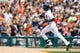 Aug 22, 2013; Detroit, MI, USA; Detroit Tigers center fielder Austin Jackson (14) runs the ball after he hits a home run against the Minnesota Twins at Comerica Park. Mandatory Credit: Rick Osentoski-USA TODAY Sports