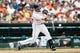 Aug 22, 2013; Detroit, MI, USA; Detroit Tigers second baseman Omar Infante (4) at bat against the Minnesota Twins at Comerica Park. Mandatory Credit: Rick Osentoski-USA TODAY Sports