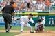 Aug 22, 2013; Detroit, MI, USA; Minnesota Twins catcher Chris Herrmann (12) steals second ahead of the tag by Detroit Tigers shortstop Jose Iglesias (1) at Comerica Park. Mandatory Credit: Rick Osentoski-USA TODAY Sports