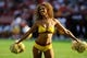 Aug 24, 2013; Landover, MD, USA; Washington Redskins cheerleader performs during the game against the Buffalo Bills at FedEX Field. Mandatory Credit: Brad Mills-USA TODAY Sports