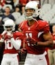Aug 17, 2013; Phoenix, AZ, USA; Arizona Cardinals wide receiver Larry Fitzgerald (11) practices during warm ups before the first quarter against the Dallas Cowboys at University of Phoenix Stadium. The Cardinals defeated the Cowboys 12-7. Mandatory Credit: Casey Sapio-USA TODAY Sports