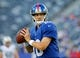 Aug 24, 2013; East Rutherford, NJ, USA; New York Giants quarterback Eli Manning (10) prior to the game against the New York Jets at MetLife Stadium. Mandatory Credit: Jim O'Connor-USA TODAY Sports
