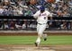 Aug 26, 2013; New York, NY, USA; New York Mets right fielder Marlon Byrd (6) scores a run against the Philadelphia Phillies during the second inning of a game at Citi Field. Mandatory Credit: Brad Penner-USA TODAY Sports