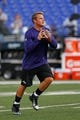 Aug 22, 2013; Baltimore, MD, USA; Baltimore Ravens quarterback Caleb Hanie (8) warms up before the game against the Carolina Panthers at M&T Bank Stadium. Mandatory Credit: Mitch Stringer-USA TODAY Sports