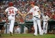 Aug 27, 2013; Washington, DC, USA; Washington Nationals left fielder Bryce Harper (34) is congratulated by first baseman Adam LaRoche (25) after scoring a run during the first inning against the Miami Marlins at Nationals Park. Mandatory Credit: Brad Mills-USA TODAY Sports